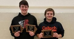 Two WDHS students holding math championship awards