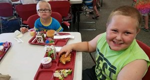 Kids eating at Summer Food program