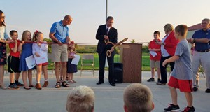 Superintendent Colpitts cutting ribbon at new addition dedication