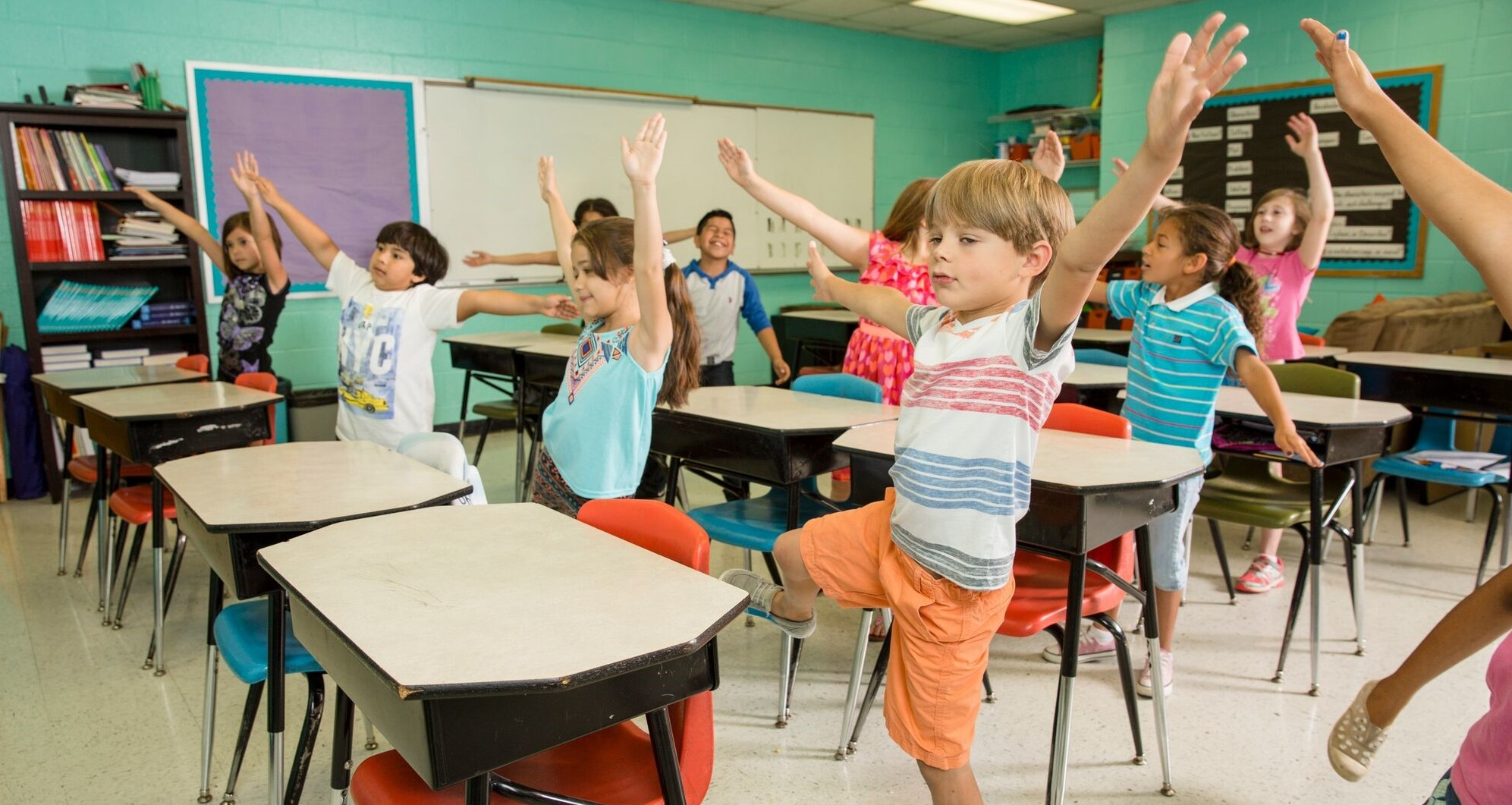 Students raising hands for GoNoodle