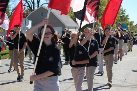 Middle school colorguard students performing in the WD homecoming parade