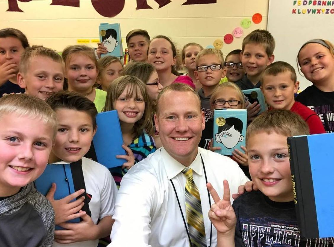 Students with principal and their book study