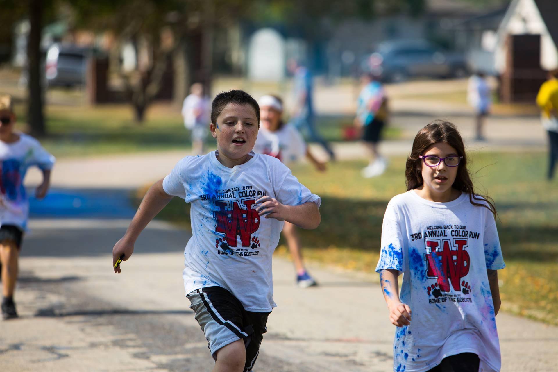 boy and girl at color run
