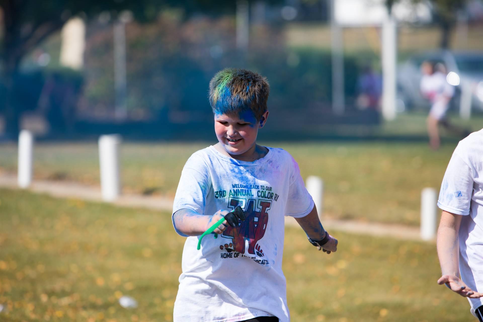 boy 8 at color run