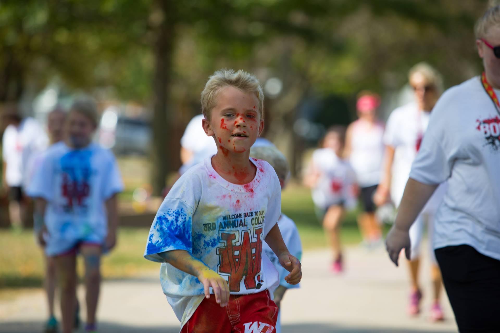 boy 14 at color run