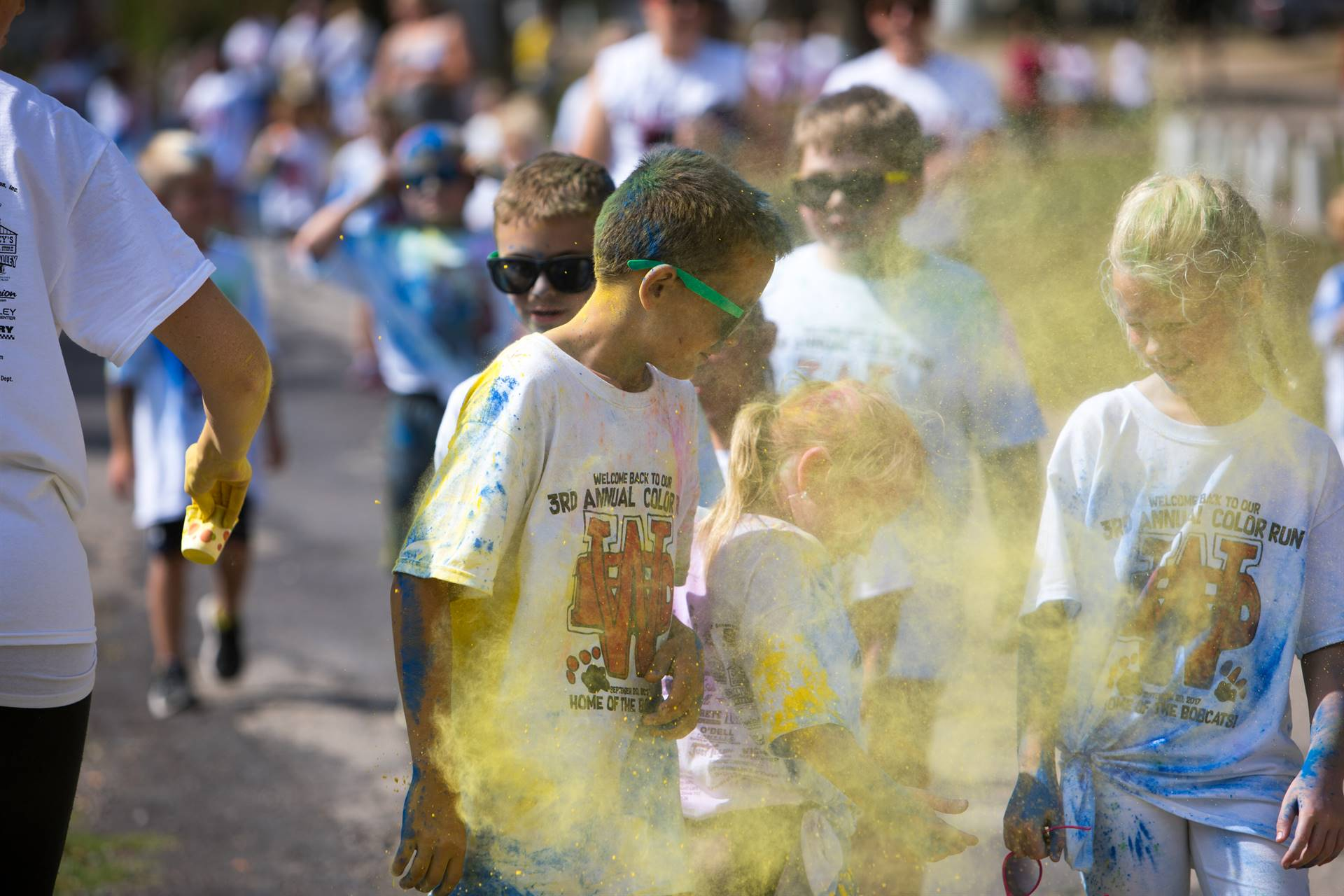Group of students with yellow on them at color run