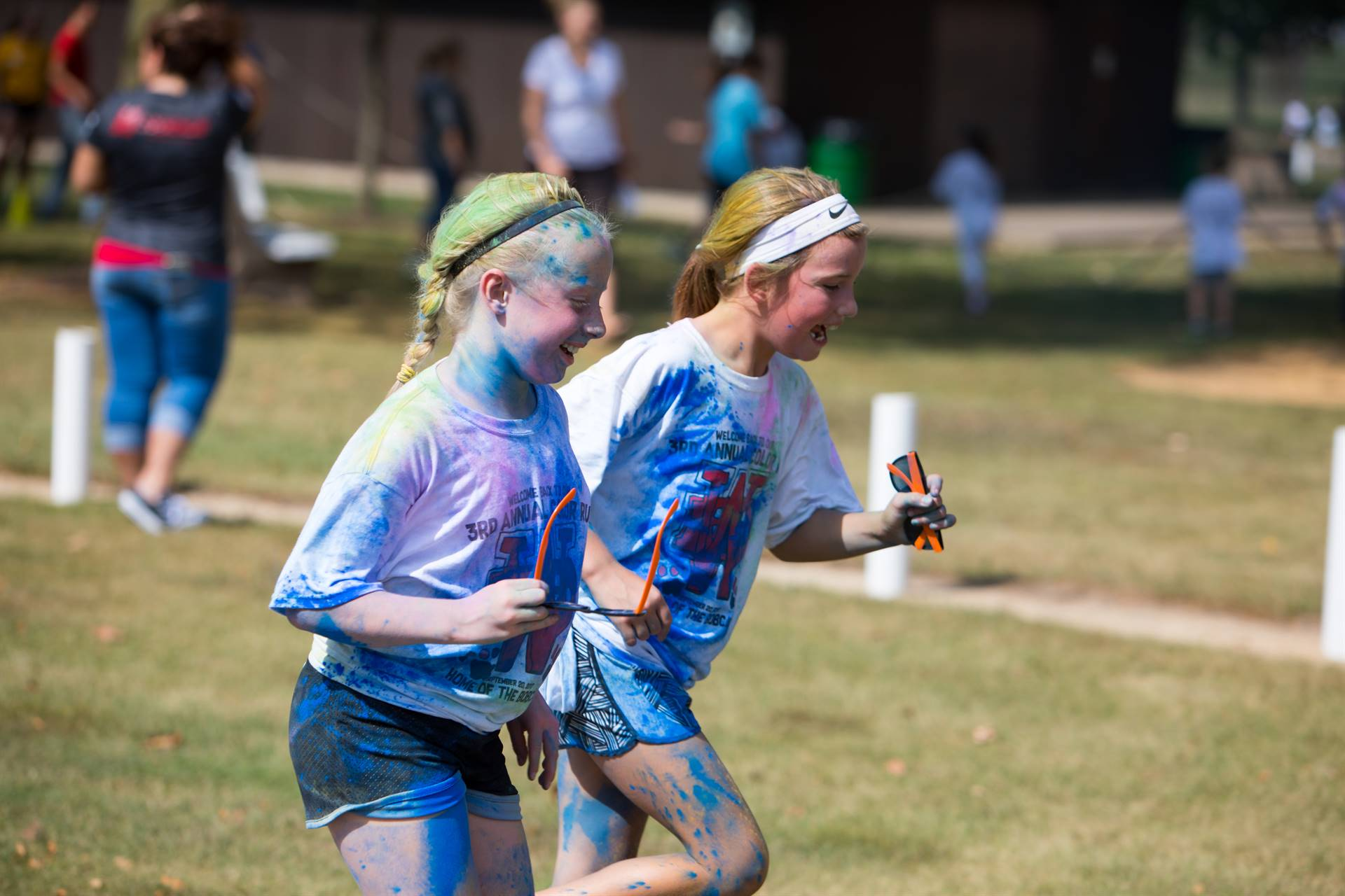 2 girls running at color run