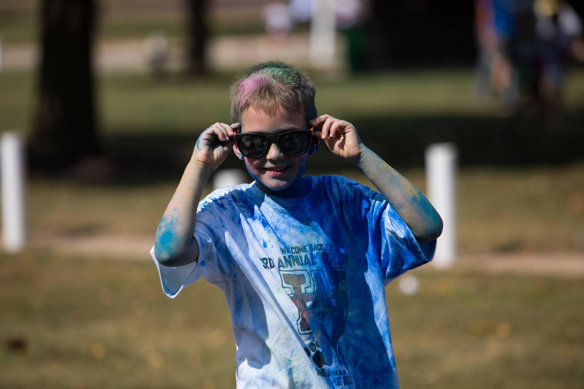 boy 12 at color run