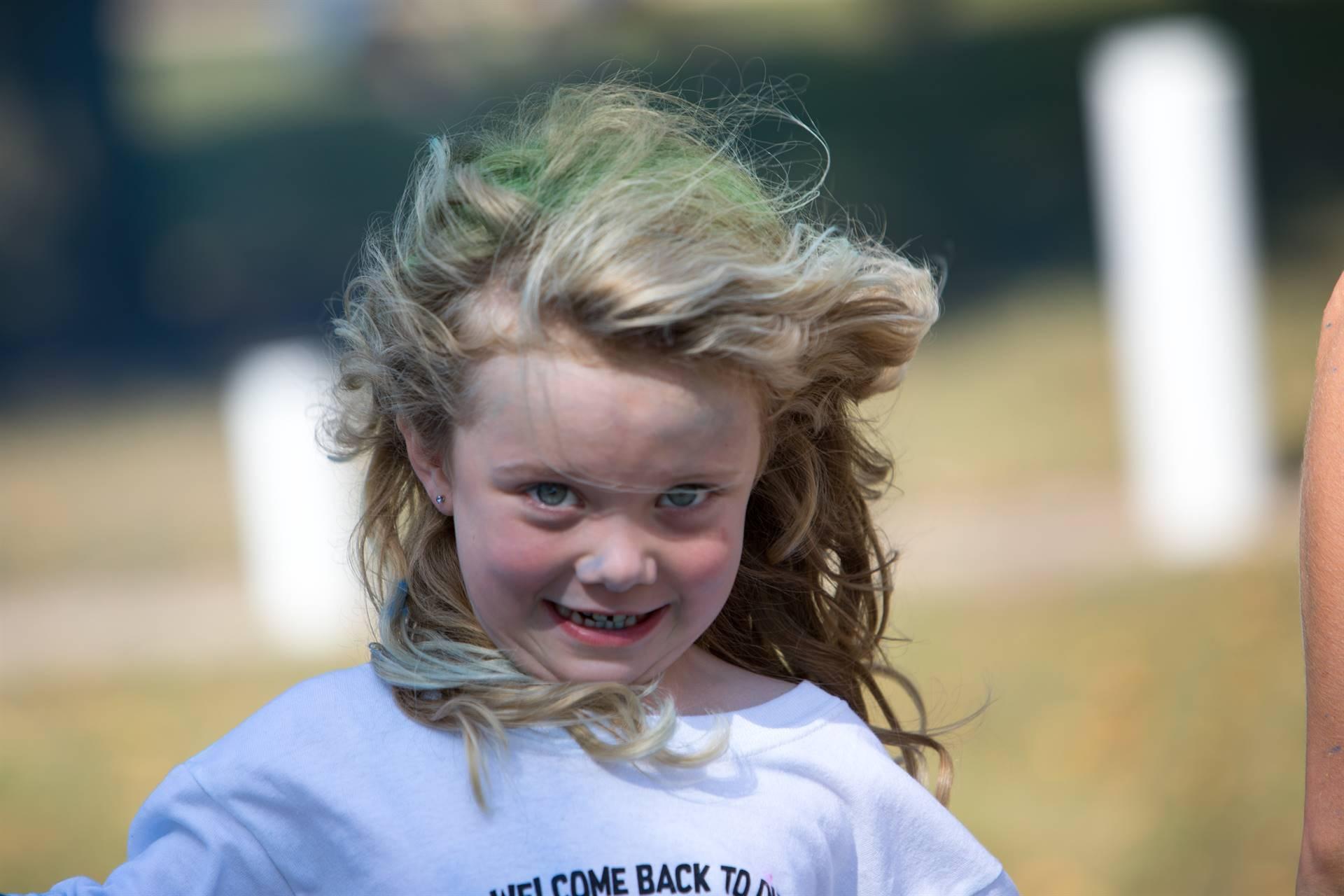 Close up of girl at color run