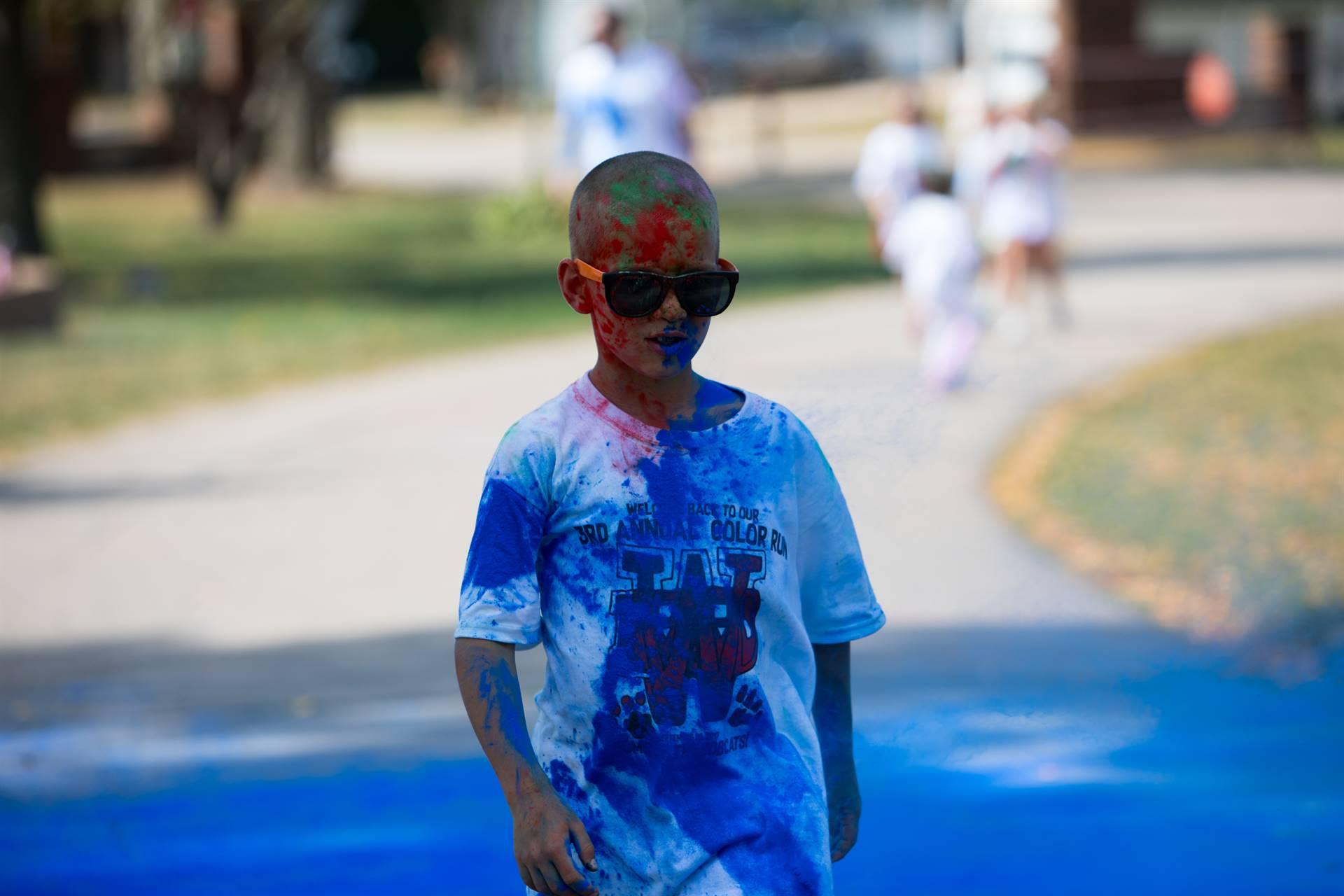 boy 10 at color run