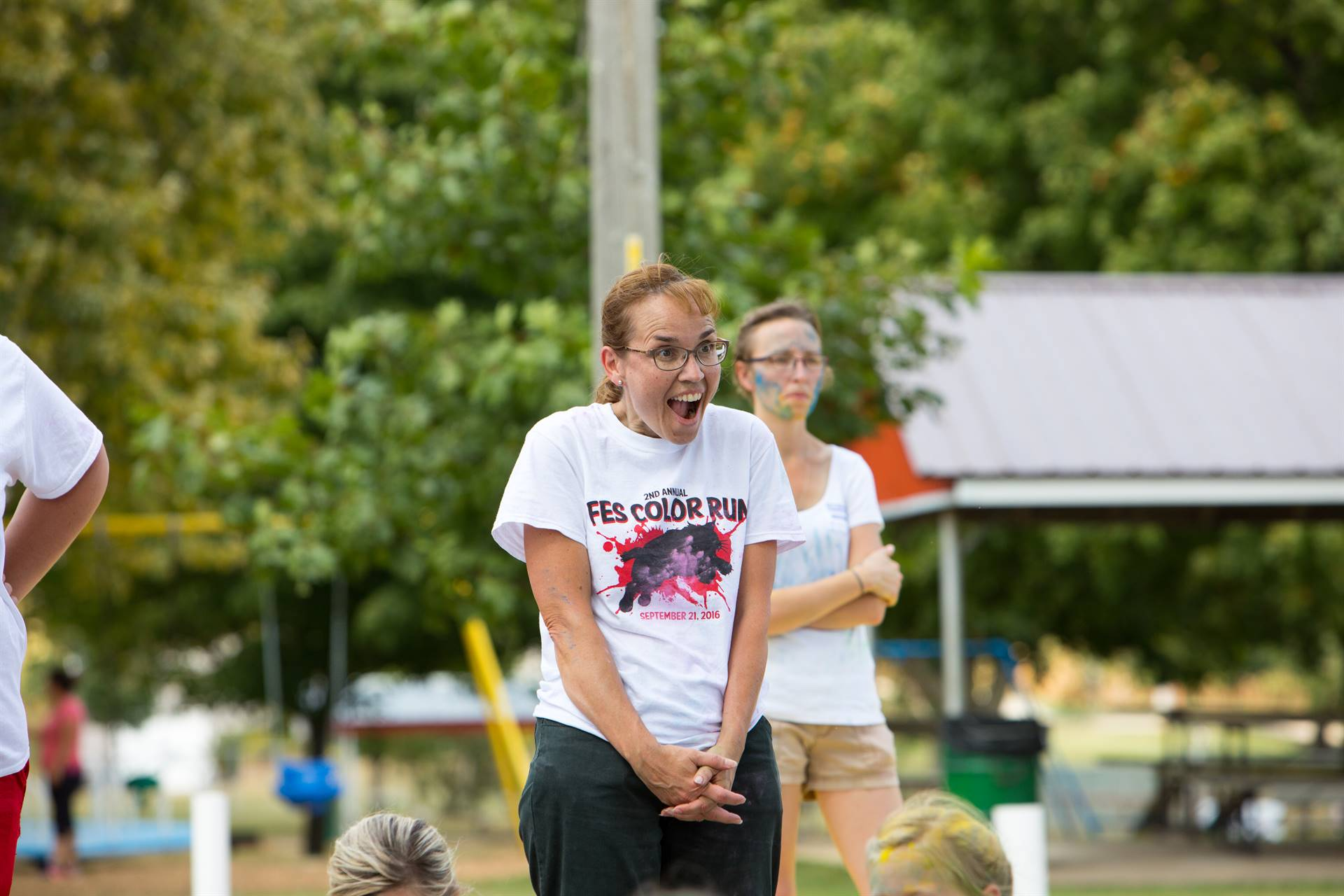 Teacher laughing at color run