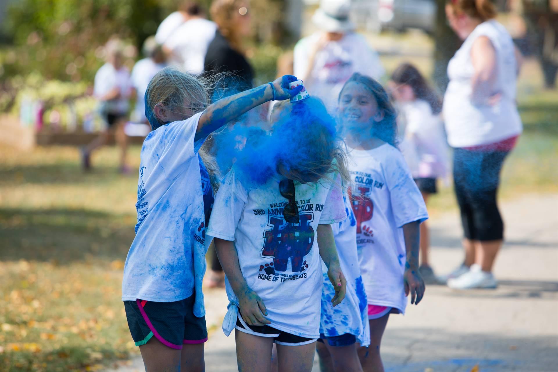 Lots of blue color on kids
