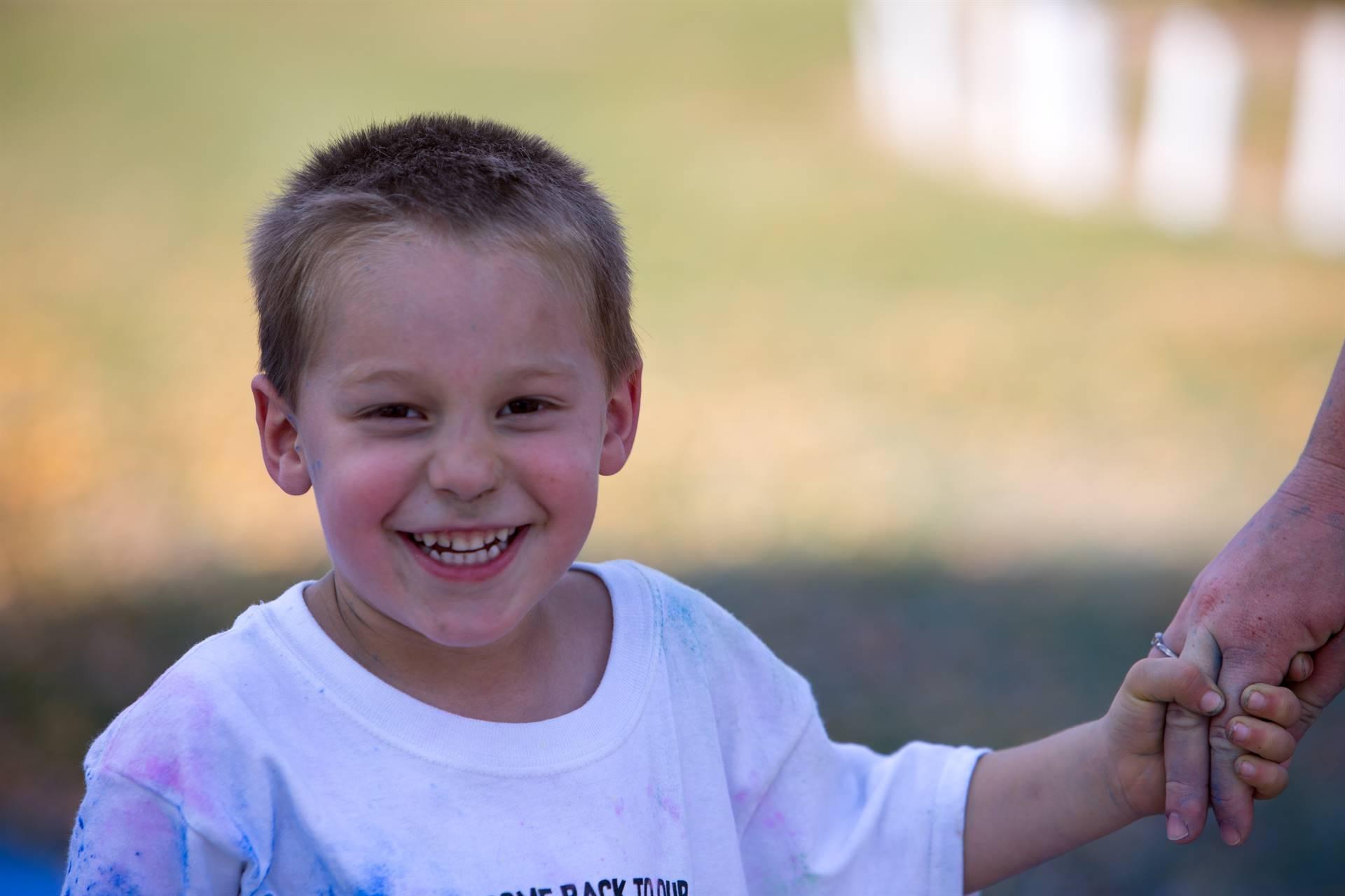 boy 7 at color run