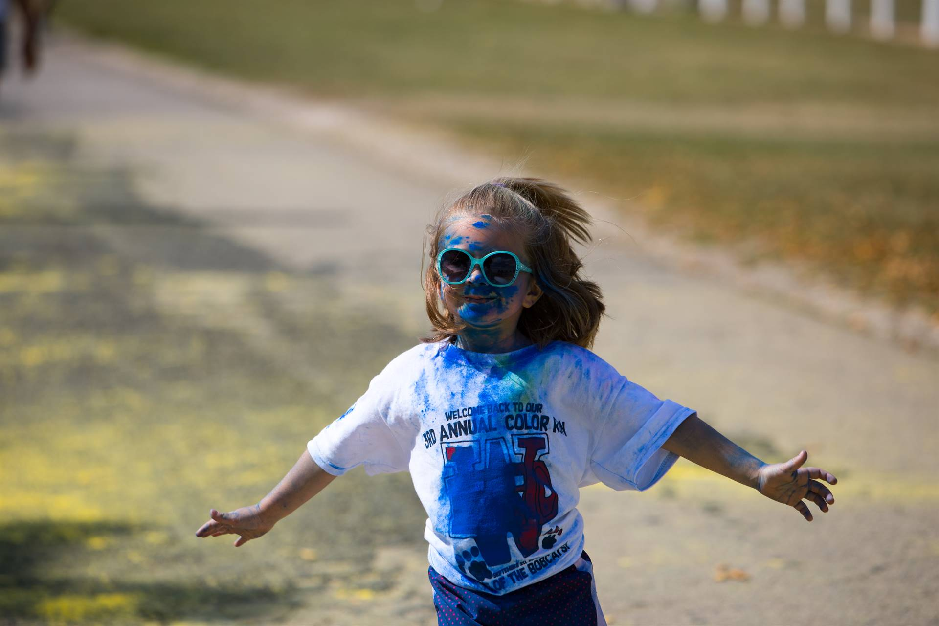 Girl 10 at color run with a splash of color