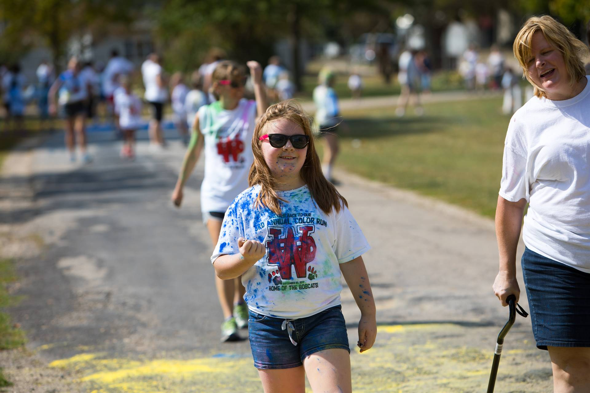Teacher with girl student at color run