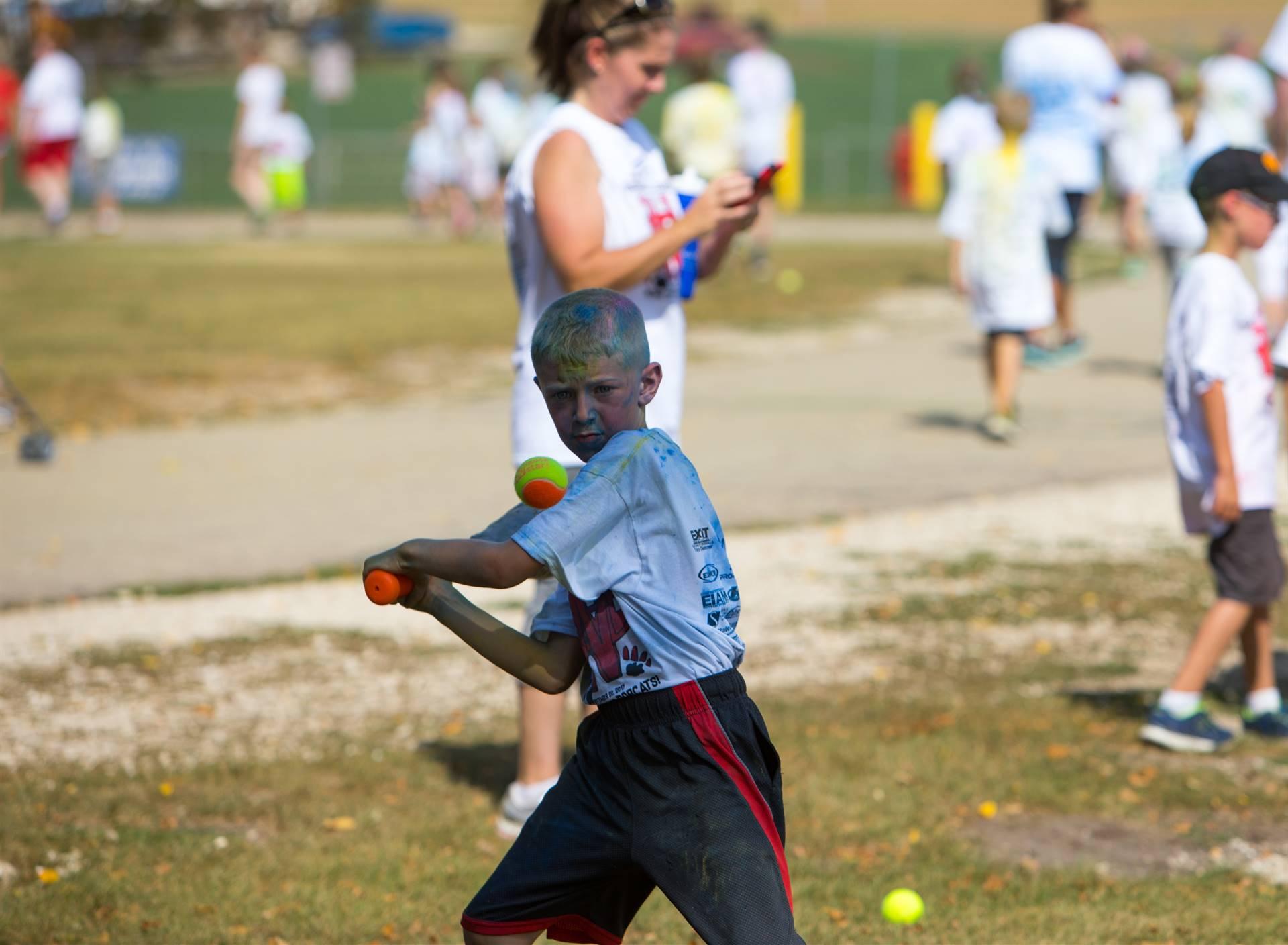 boy hitting ball with bat 2