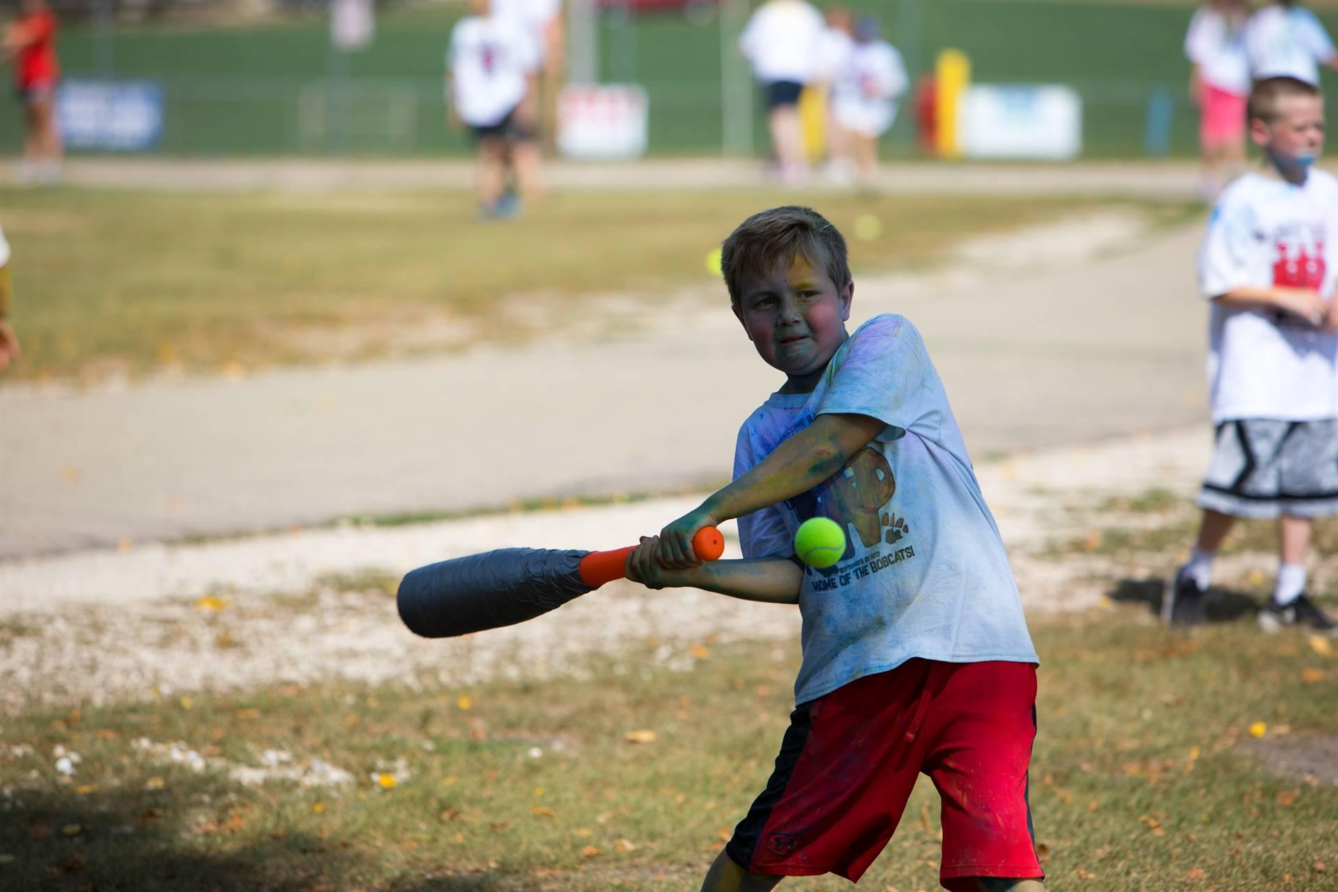 boy hitting ball 4