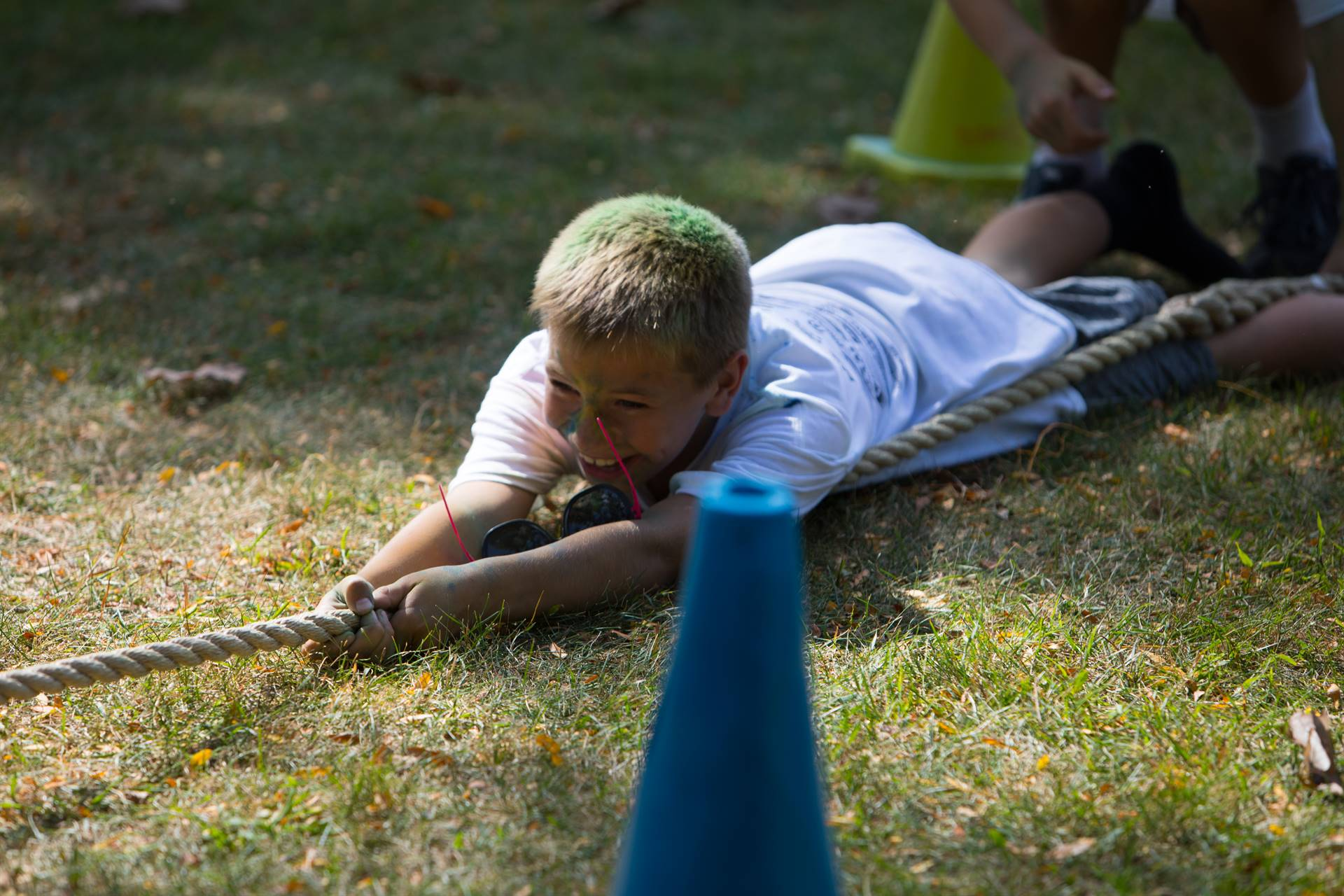 Boy on ground at tug of war