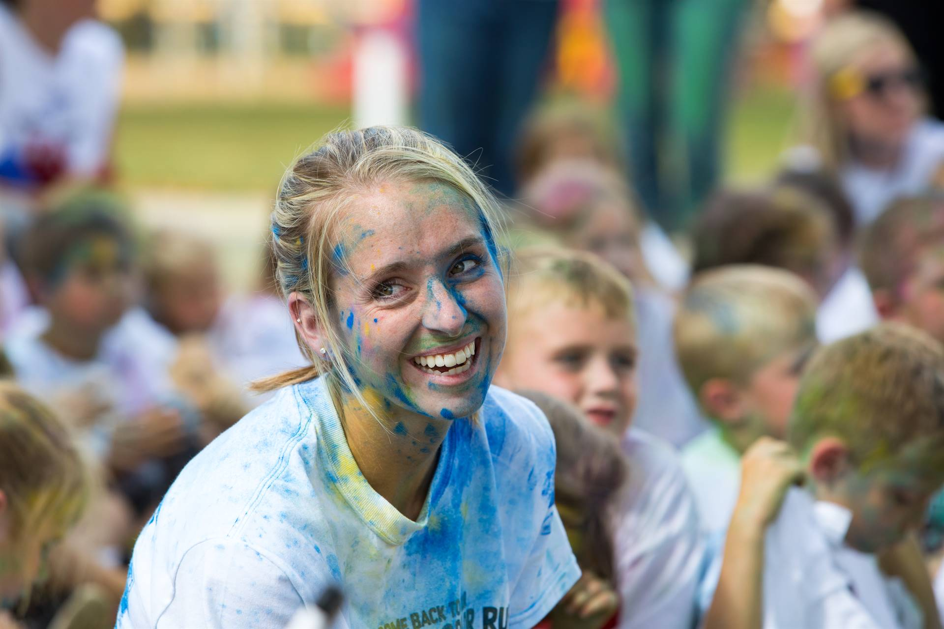Teacher smiling after color run