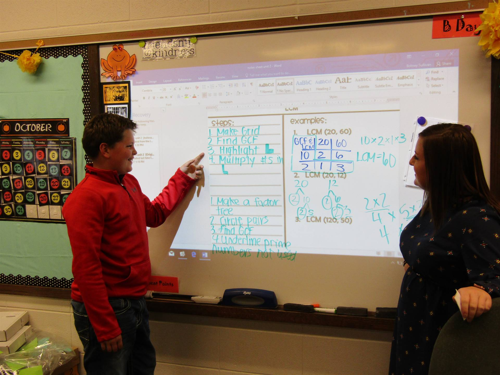 DMIS student receives instruction on the whiteboard