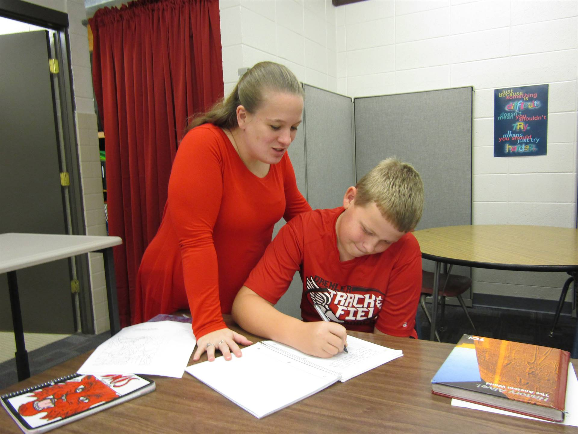 Drexler Middle Intermediate School student recieves instruction for homework