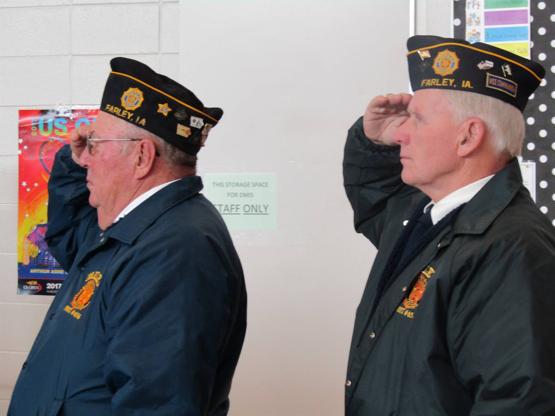 DMIS Legion members salute the flag