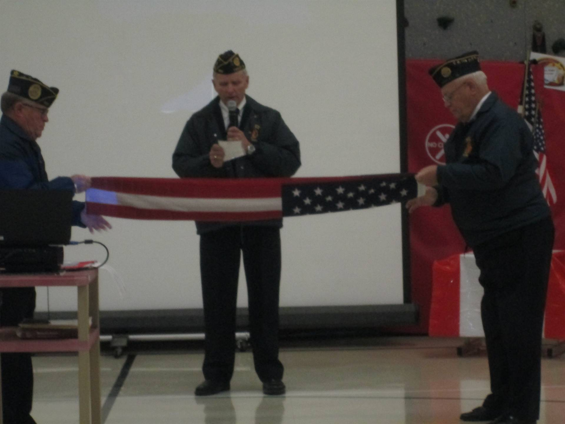 Farley Elementary veterams folding American flag