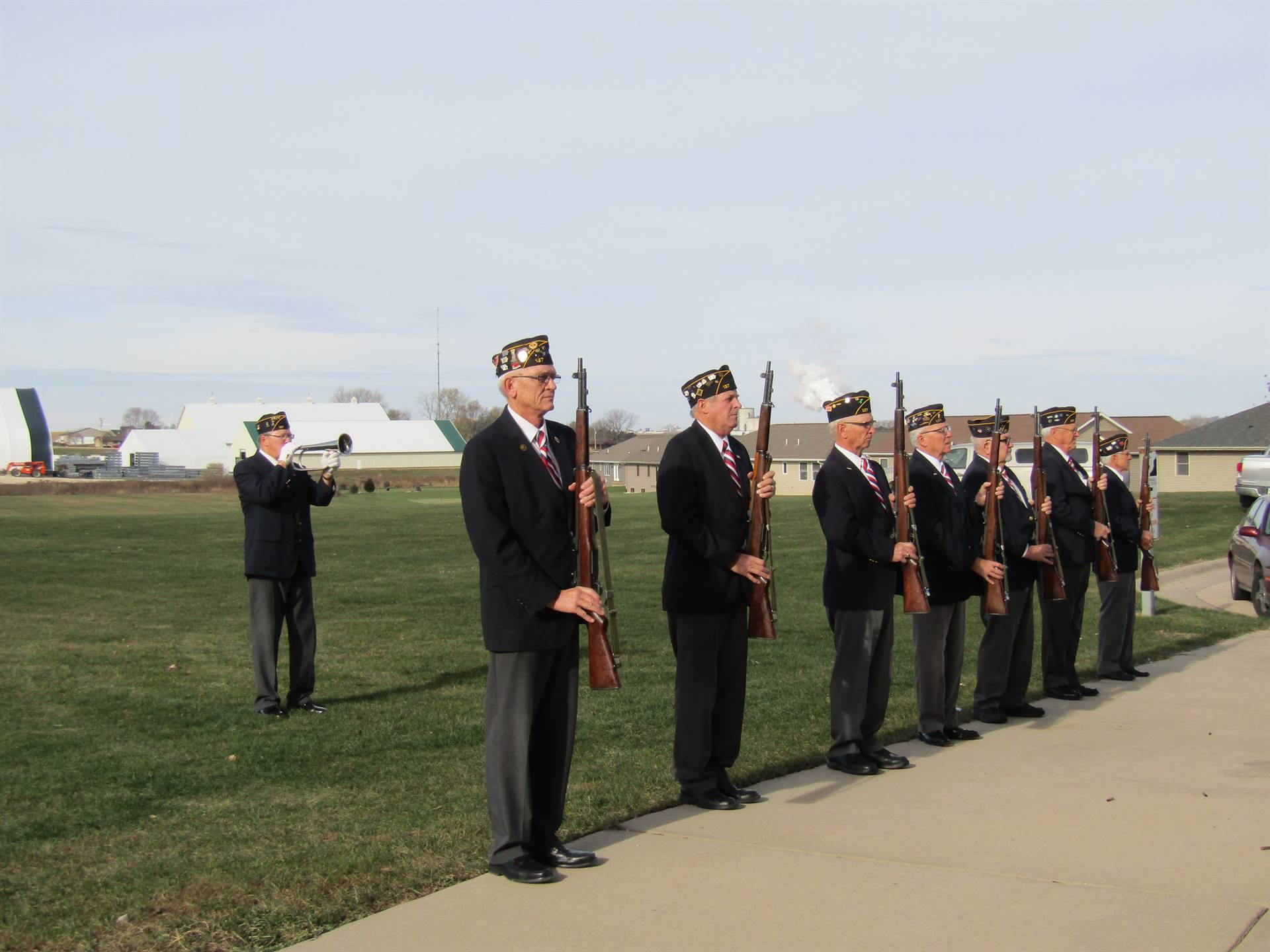 Dyersville Elementary Veteran playing taps with Firing squad standing guard