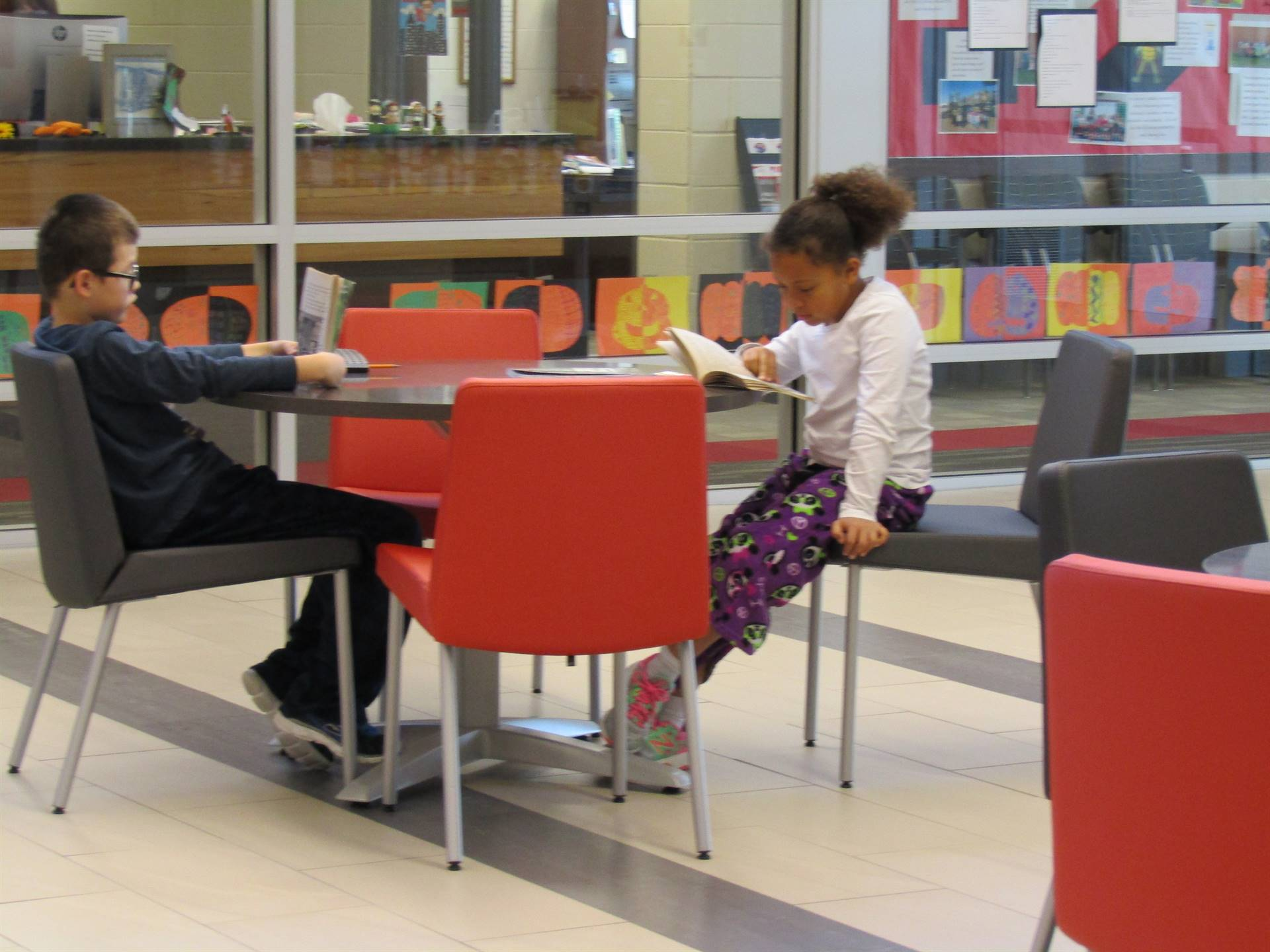2 students reading in our lobby.