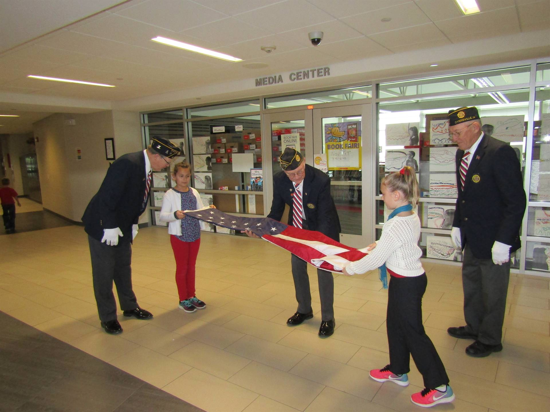Flag folding with help from Veterans.