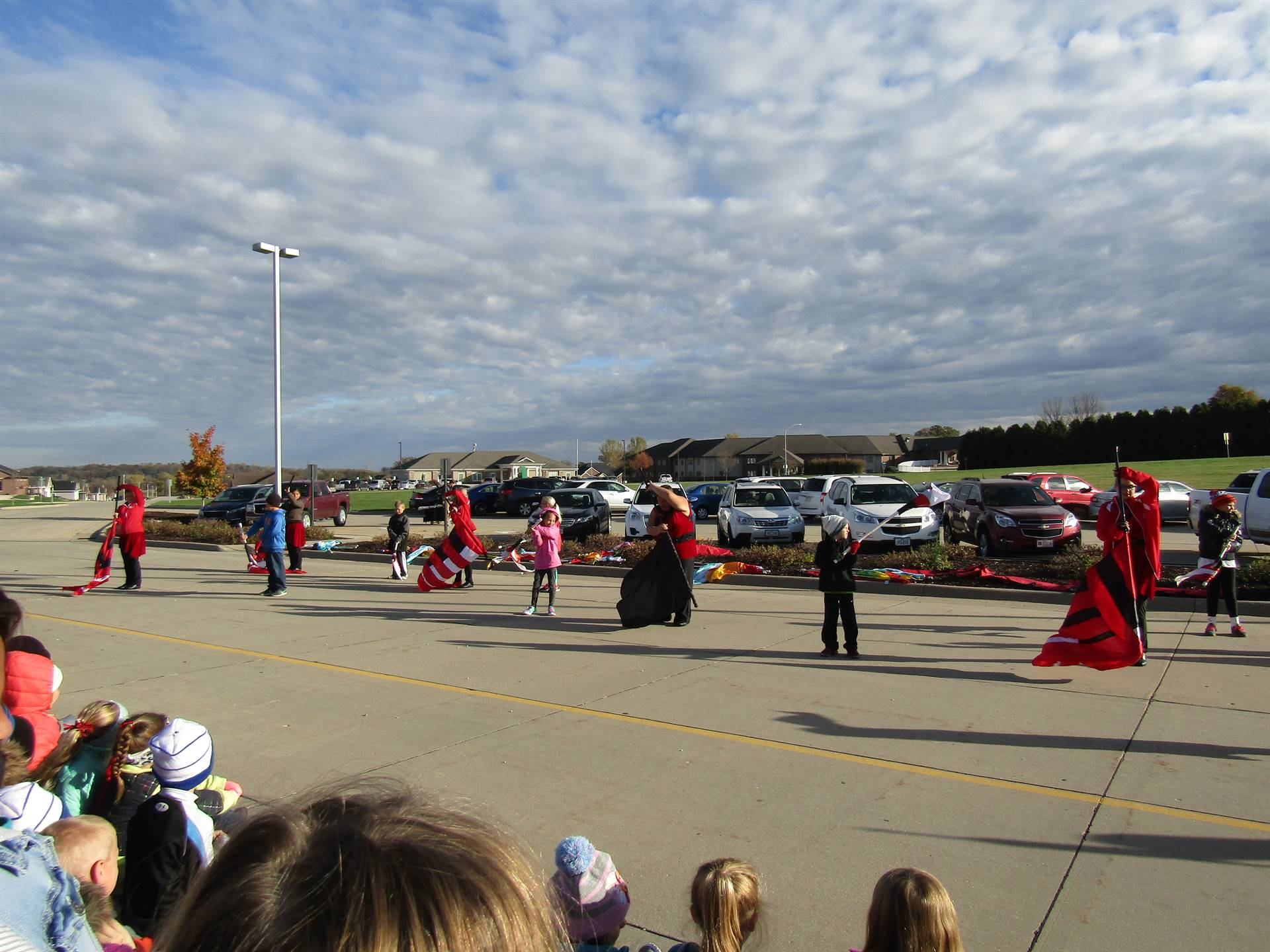 Dyersville Elementary students and WD flag team doing flag routine