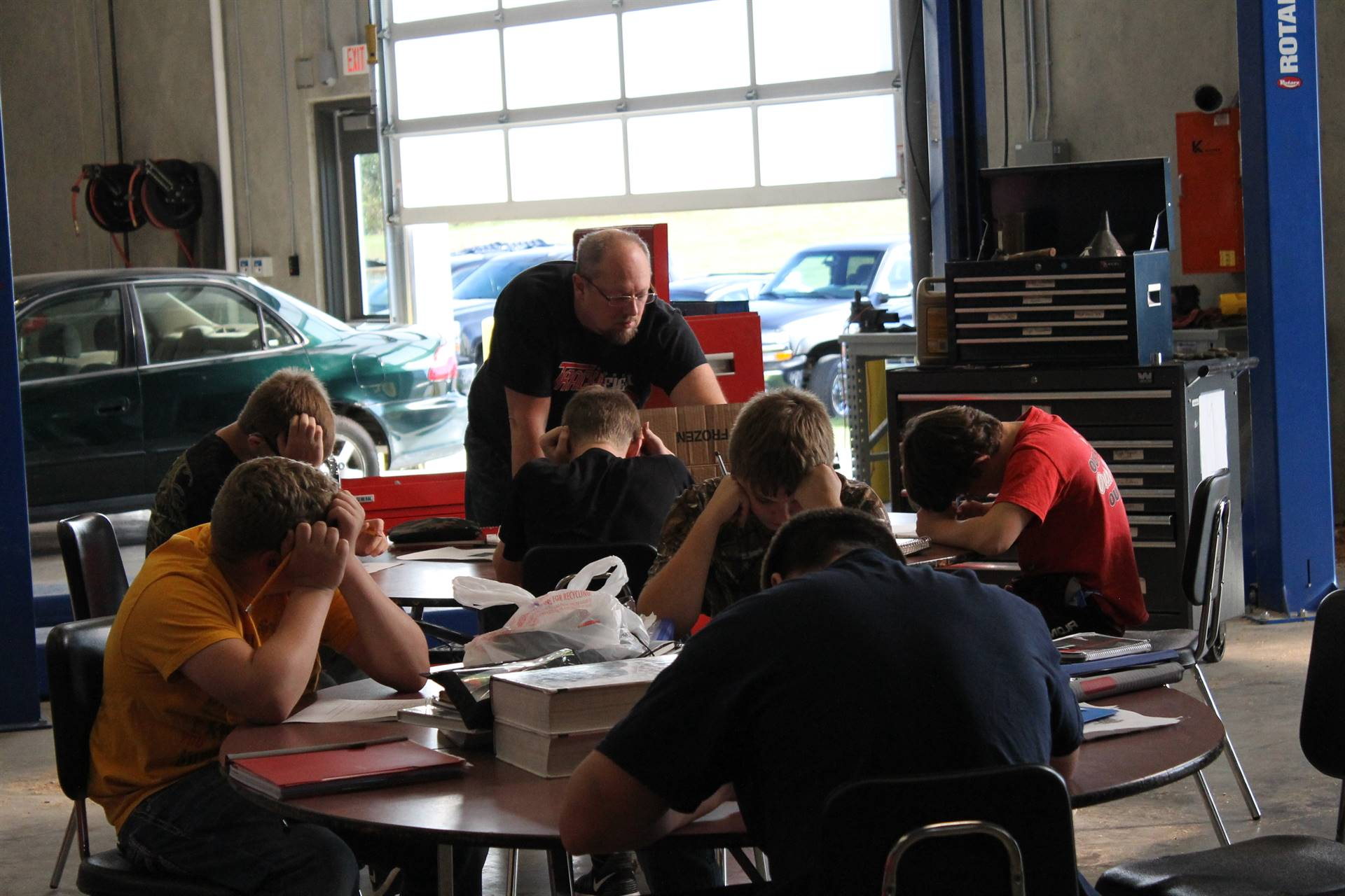 WDHS teacher Mr. Seay working with students in Auto class
