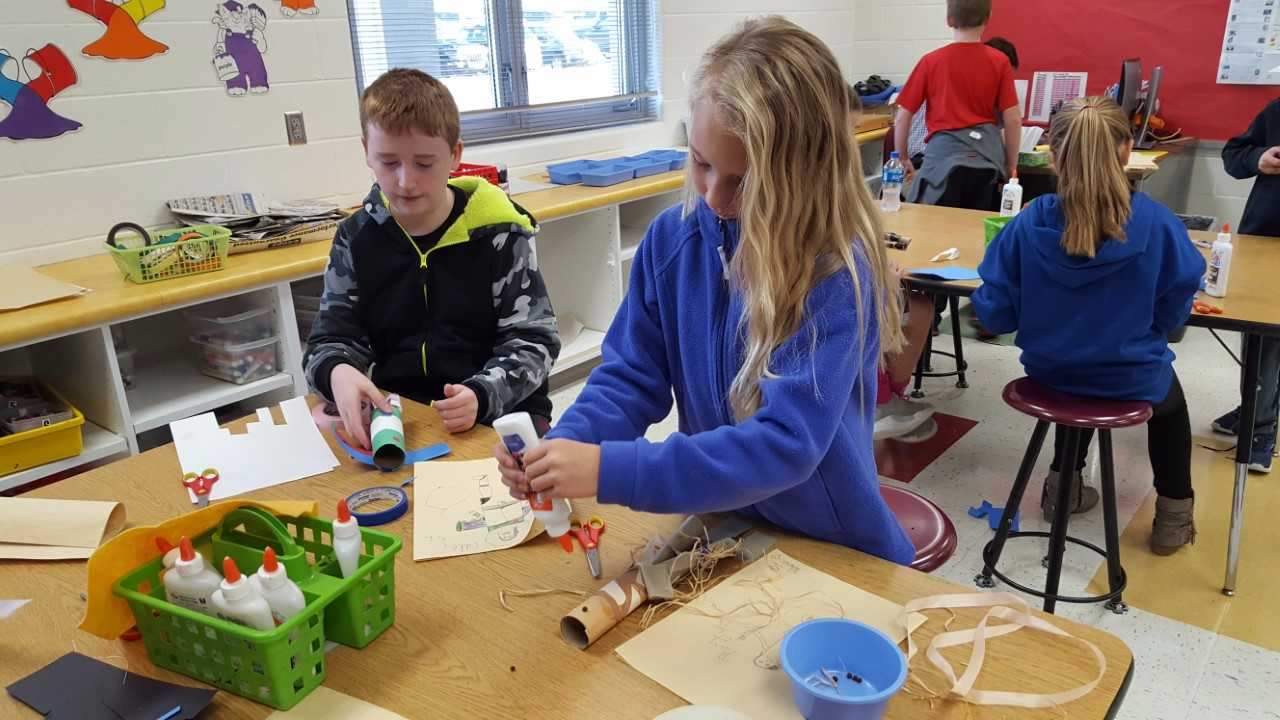 Elementary students working on art project