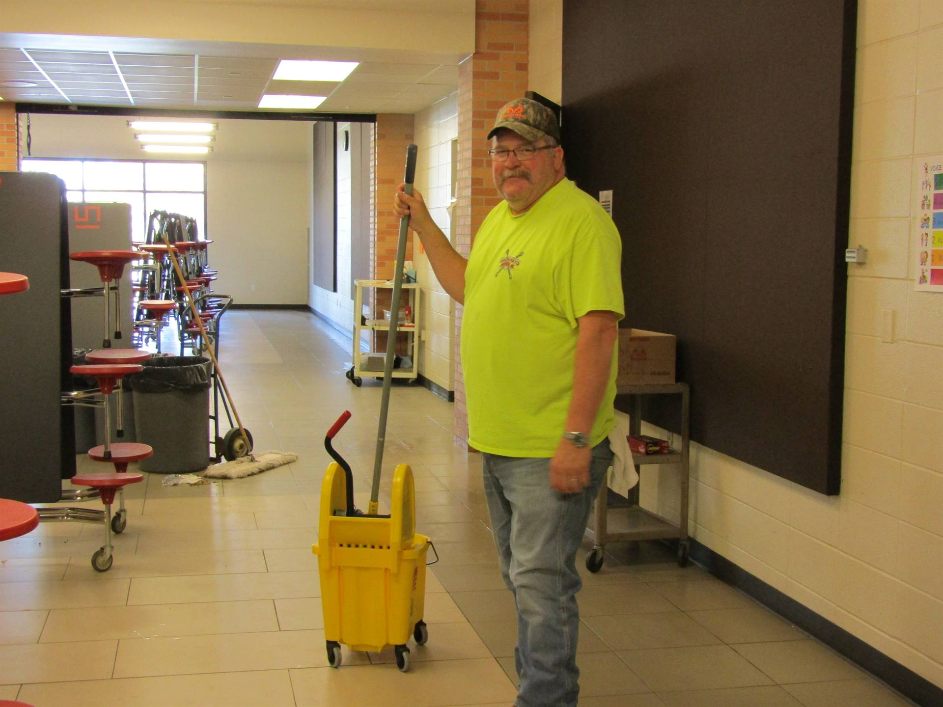 Custodian prepares floor for cleaning
