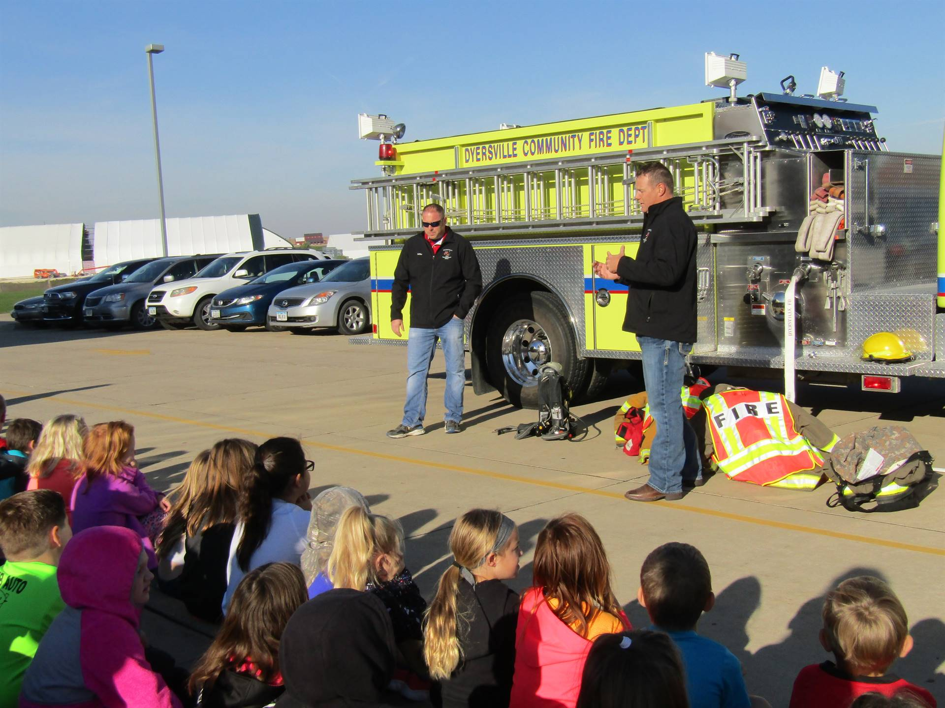 Fireman Comer and Fireman Wessels talking to 1st and 2nd graders