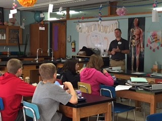 Chris Casey Physical Therapist presenting to 7th & 8th grade students