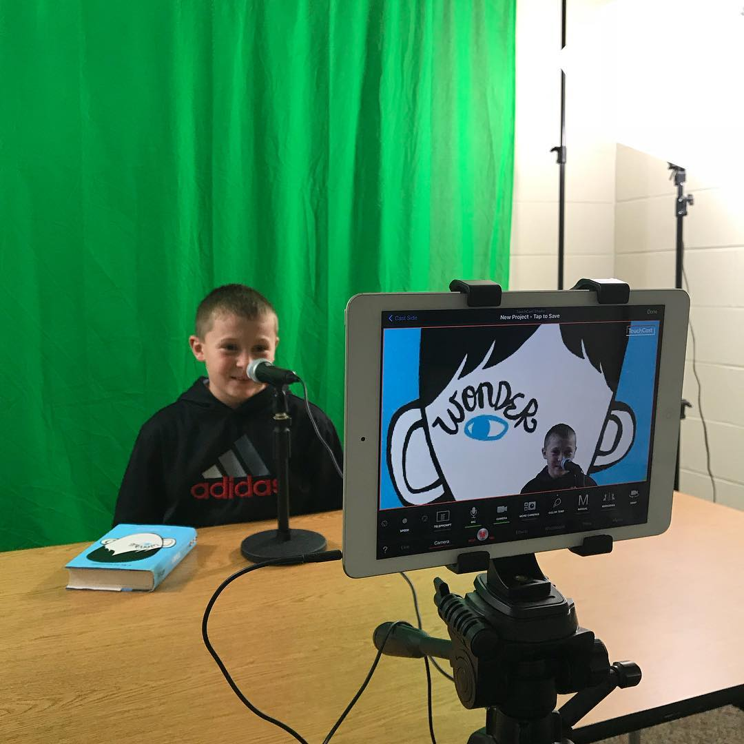 A student works on a green screen video project
