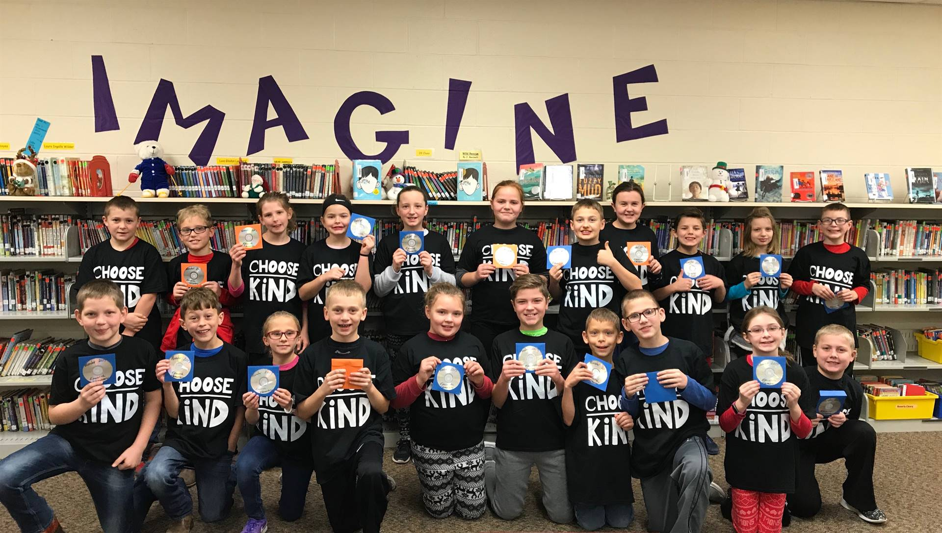 Fourth grade students received t-shirts saying choose kind from their book study of Wonder