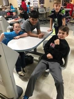 group of boys watching classmates bowl