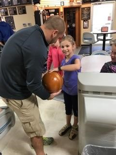 Teacher showing student how to bowl