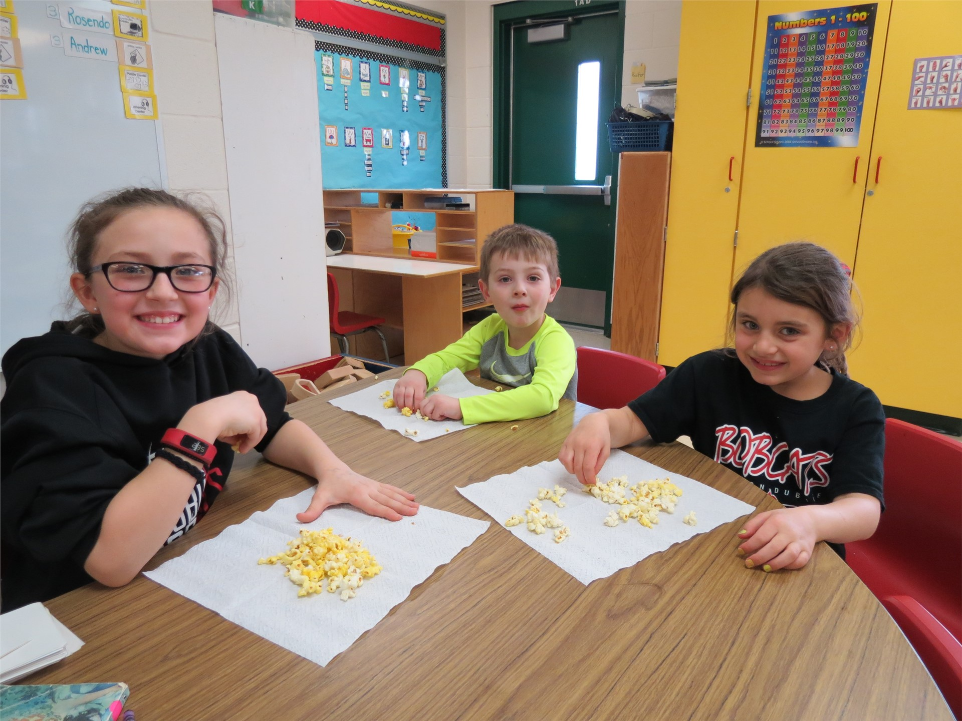 Kids eating popcorn during Bobcat families