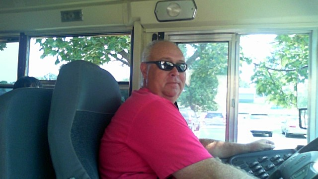 photo of trip driver Loras Mauer in his bus