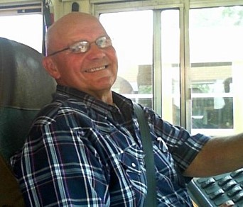 photo of Mel Wilgenbusch seated in his bus