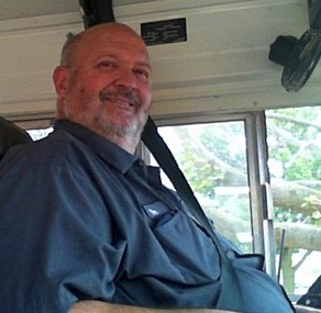 photo of Dan Friedmann seated in his bus