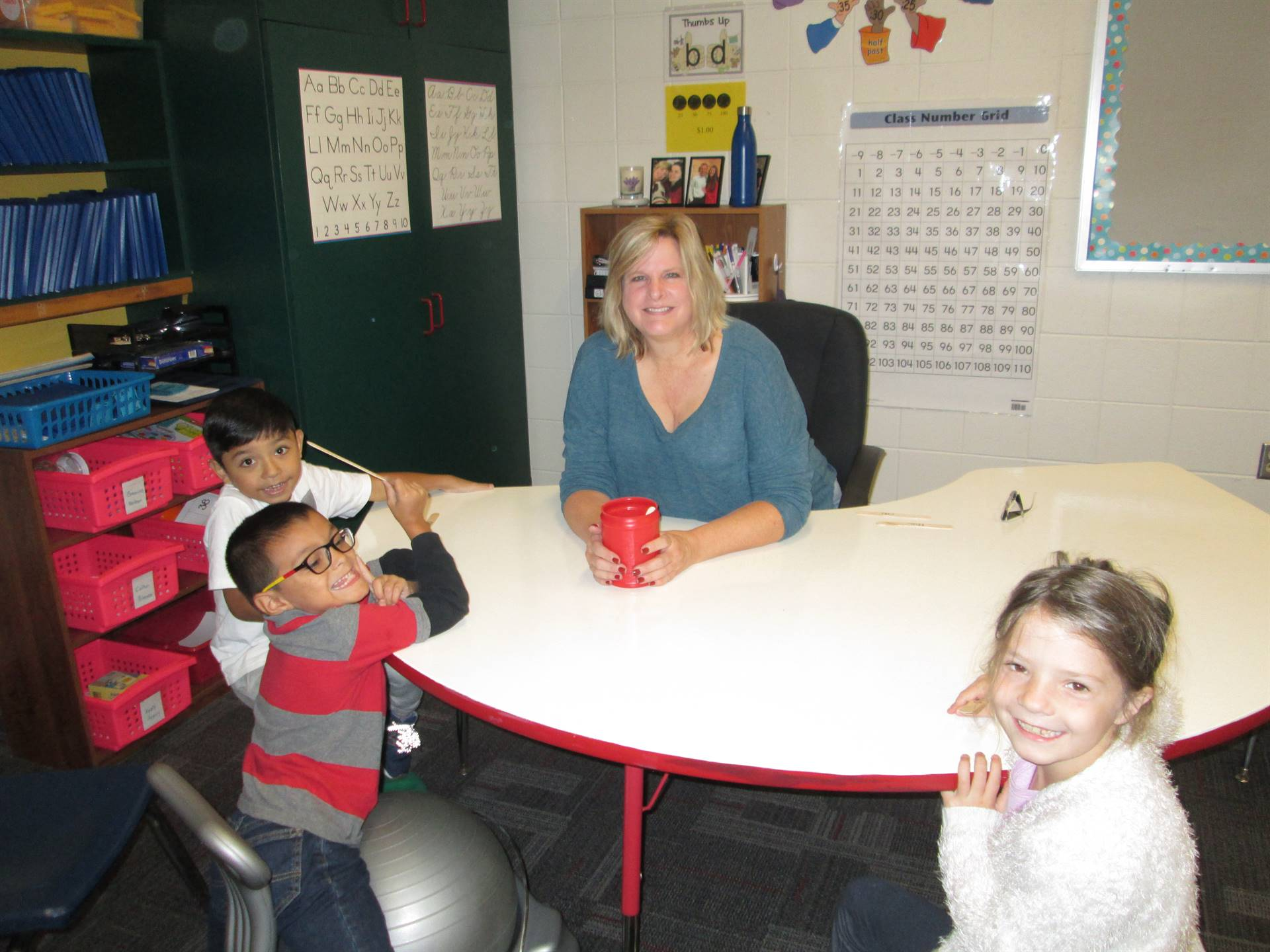 teacher working with small group