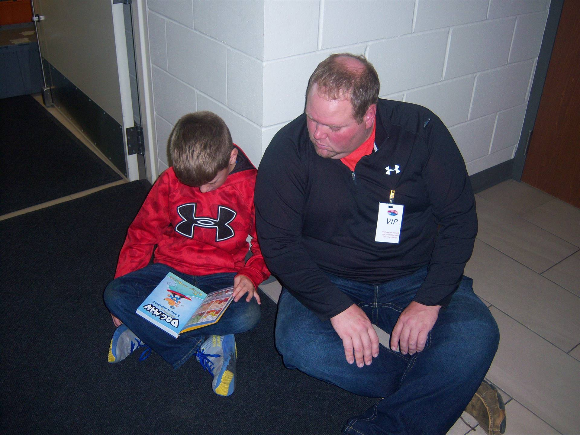 Dad reading with 3rd grade son