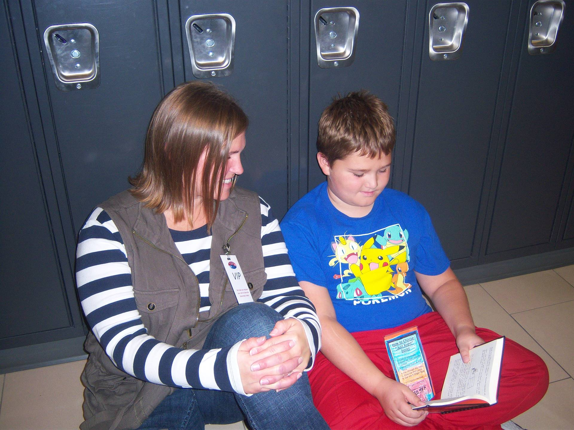 Mom reading with 3rd grade son