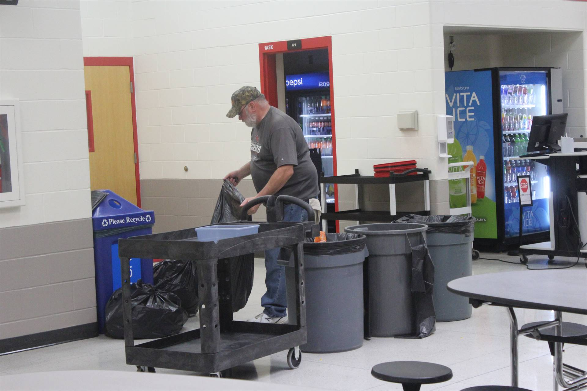 Custodian keeping high school clean