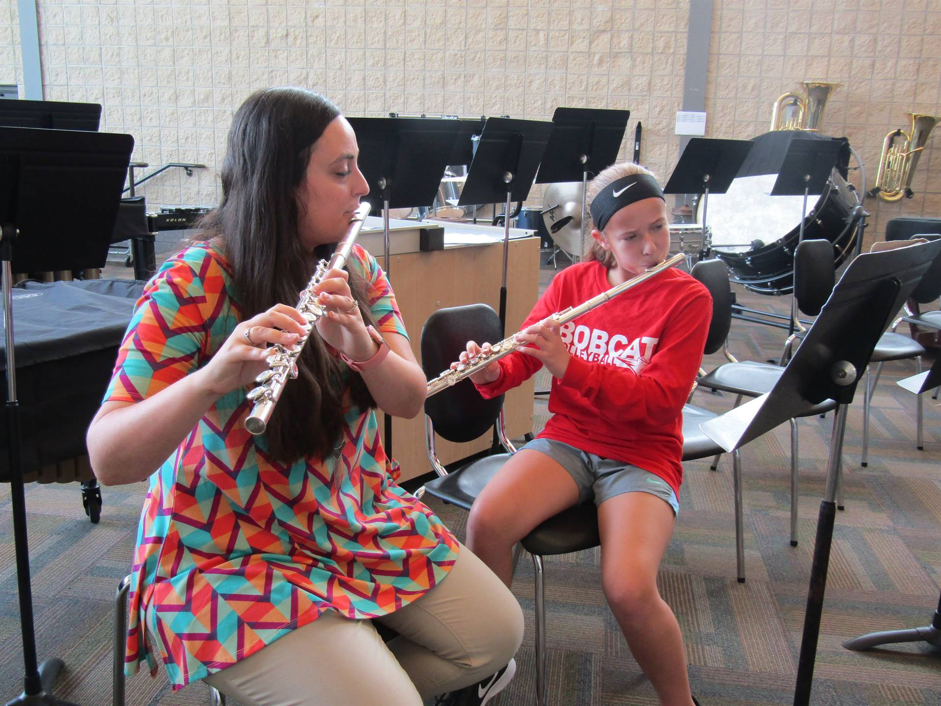 7th grade student takes instruction from Band teacher Mrs. Waymire