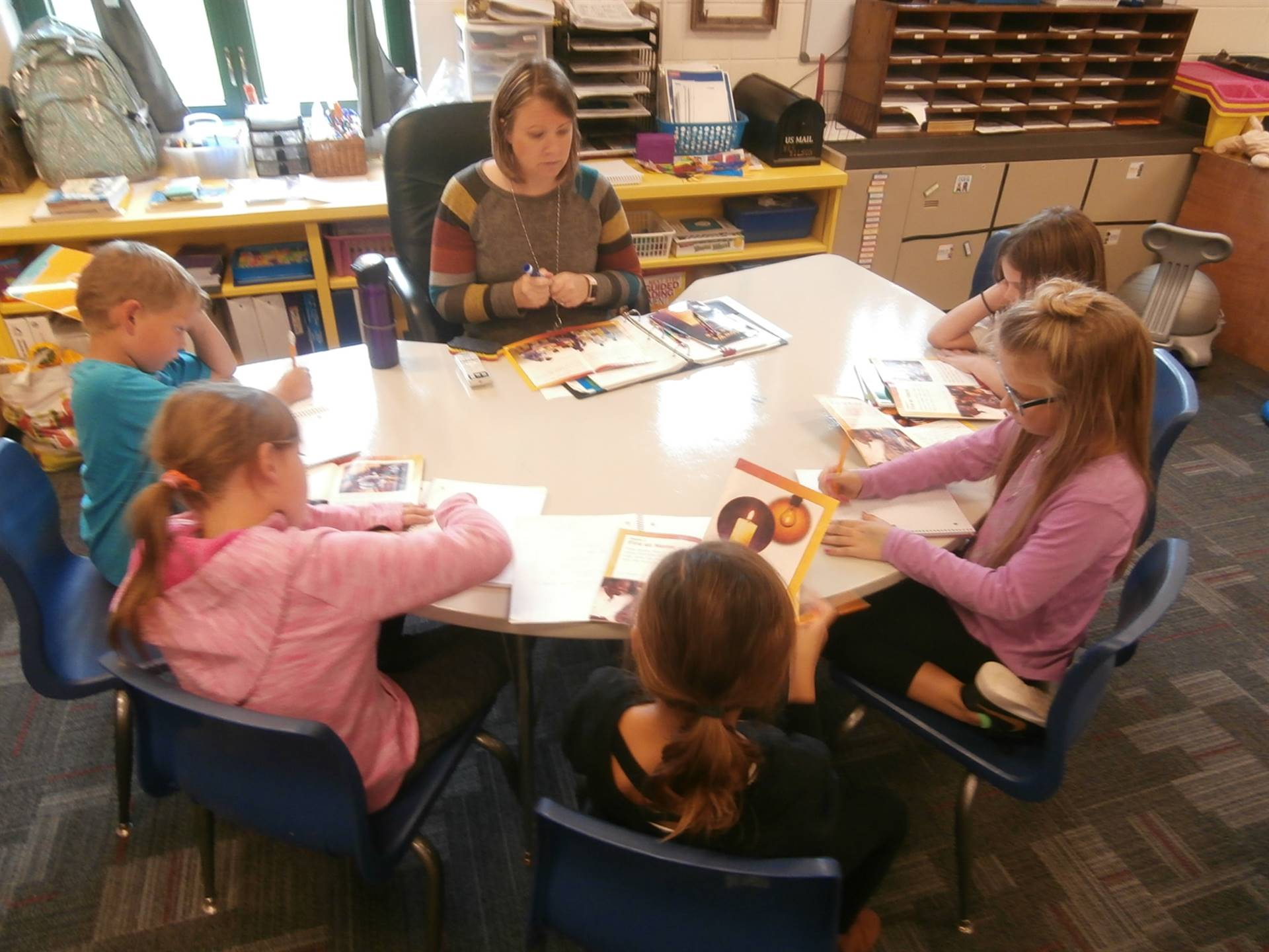 Teacher teaching students a reading lesson